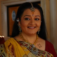 A still image of Apra mehta as Jhumki Bua