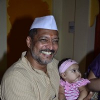 Nana Patekar poses with a small child on Ganesh Chaturthi