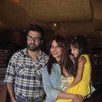 Bipasha Basu and Harman Baweja pose with a kid at the Special Screening of Creature 3D