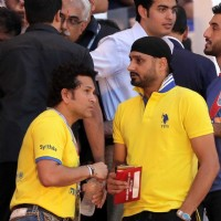 Sachin Tendulkar chats with Harbhajan Singh at the Opening Ceremony of the Indian Super League