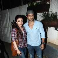 Kunal Khemu and Soha Ali Khan pose for the media at the Special Screening of Ben Affleck's Gone Girl