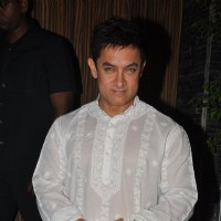 Aamir Khan poses for the media at his Diwali Bash
