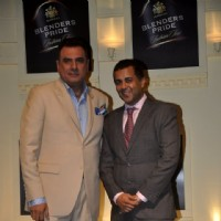 Boman Irani and Chetan Bhagat pose for the media at Blender's Pride Tour