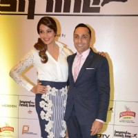 Bipasha Basu and Rahul Bose pose for the media at Airtel Delhi Marathon