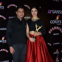 Bhushan Kumar poses with wife Divya Kumar at the Sansui Stardust Awards Red Carpet