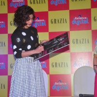 Priyanka Chopra signs her autograph at the Grazia's New Issue