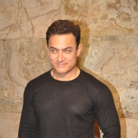 Aamir Khan poses for the media at the Special Screening of P.K. for Sanjay Dutt