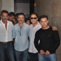 Team poses for the media at the Special Screening of P.K. for Sanjay Dutt