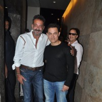 Aamir Khan and Sanjay Dutt pose for the media at the Special Screening of P.K.