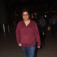 Vashu Bhagnani poses for the media at Airport
