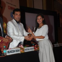 Rashmi Desai receives an award at Golden Achiever Awards