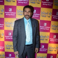 Mukesh Rishi poses for the media at Charan Singh's Lohri Celebration