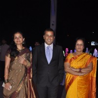 Chetan Bhagat poses with family at Kush Sinha's Wedding Reception