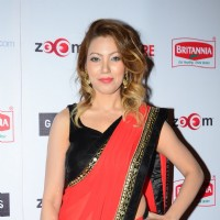 Moonmoon Dutta poses for the media at Filmfare Nominations Bash