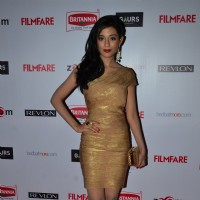 Amrita Rao poses for the media at Filmfare Nominations Bash