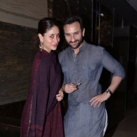 Saif Ali Khan and Kareena Kapoor pose for the media at Soha Ali Khan's Mehendi Ceremony