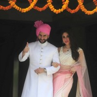 Saif Ali Khan and Kareena Kapoor pose for the media at Soha Ali Khan and Kunal Khemu's Wedding