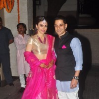 Soha Ali Khan and Kunal Khemu pose for the media at their Wedding Reception