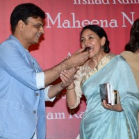 Irshad Kamil was snapped feeding a piece of cake to Deepti Naval at the Book Launch
