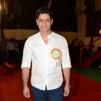 Mohit Raina poses for the media at the Annual Day of Children's Welfare Centre High School