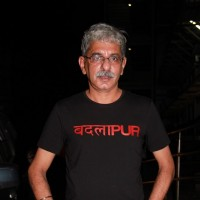 Sriram Raghavan poses for the media at the Special Screening of Badlapur