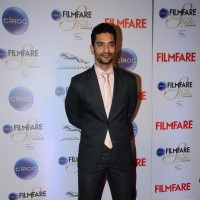 Angad Bedi poses for the media at Filmfare Glamour and Style Awards