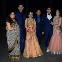 Tulsi Kumar poses with her family members at her Wedding Reception