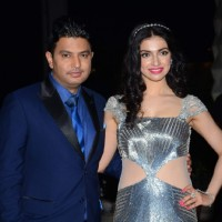 Bhushan Kumar poses with wife Divya Kumar at Tulsi Kumar's Wedding Reception