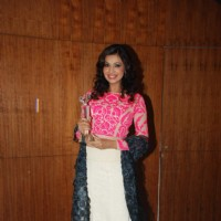 Aanchal Kumar poses with her award at Young Environmentalists Trust Women Achievers Awards