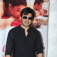 Ajay Chaudhary poses for the media at Charisma Spa