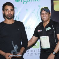 Shabbir Ahluwalia receives a trophy at at Gold Charity Match