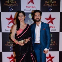 Disha Parmar and Nakuul Mehta pose for the media at Star Parivaar Awards 2015