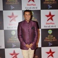 Chetan Bhagat poses for the media at Star Parivaar Awards 2015