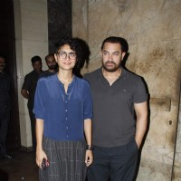 Aamir Khan and Kiran Rao pose for the media at the Special Screening of Dil Dhadakne Do