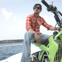 Zayed Khan sitting on a bike | Blue Photo Gallery