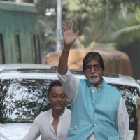 Amitabh Bachchan waving at fans during his shoot in Kolkata