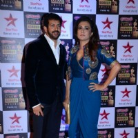 Kabir Khan poses with wife Mini Mathur at the 22nd Annual Star Screen Awards
