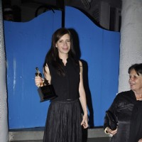 Kalki Koechlin poses with her Trophy delivered to her by Sonam Kapoor at Olive
