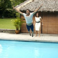 Akshay Kumar jumping in a swimming pool