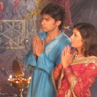 Sumit and Kumkum praying to God