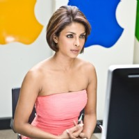 Priyanka Chopra sitting in front of computer