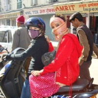 Ratan Rajput sitting on a bike
