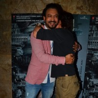 Irrfan Khan and Shah Rukh Khan hugs each other at the special screening of Madaari