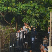 Shah Rukh Khan greets his fans with AbRam