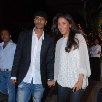Arjun Rampal and his wife Mehr Jessia at Raajneeti film success bash at Novotel | Raajneeti Event Photo Gallery