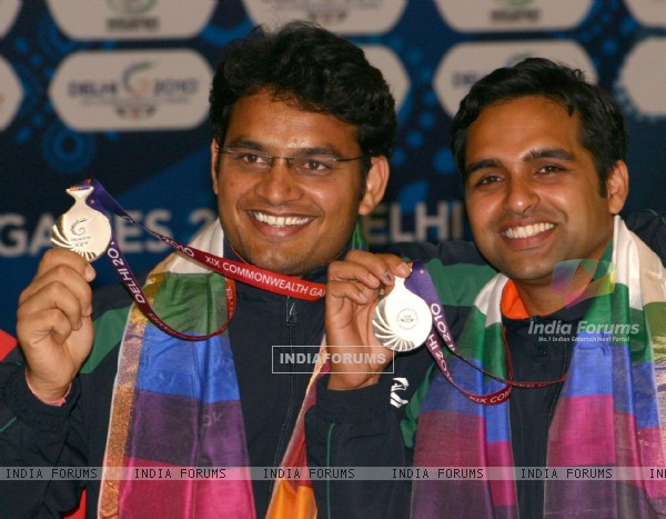 Omkar Singh and Deepak Sharma after winning the Silver in Shooting Pairs 50 M Pistol Men, event at the 19 Commonwealth Games 2010 in New Delhi