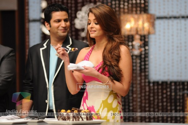 Aishwarya while tasting a special Black forest cake on the sets of Master Chef India