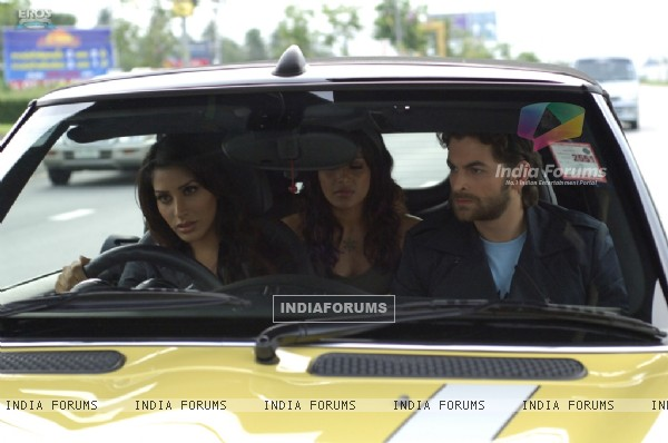 Neil,Bipasha and Sophie sitting on a taxi