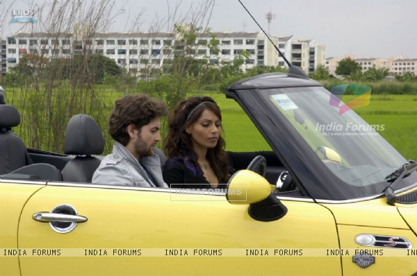 Neil and Bipasha listening a radio