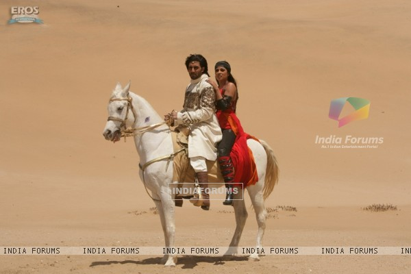 Abhishek and Priyanka sitting on a horse
